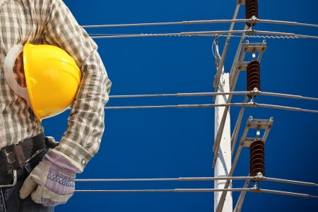 utility pole: engineer with high voltage electricity pole in blue sky Stock Photo