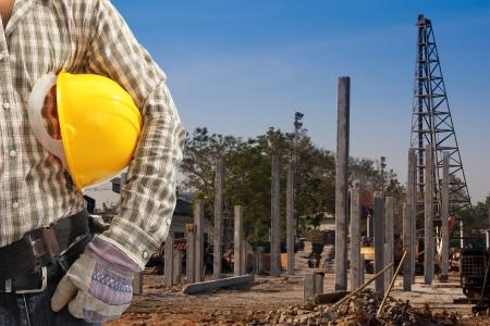 precast: Pile driver  works to set precast concrete piles in a construction area