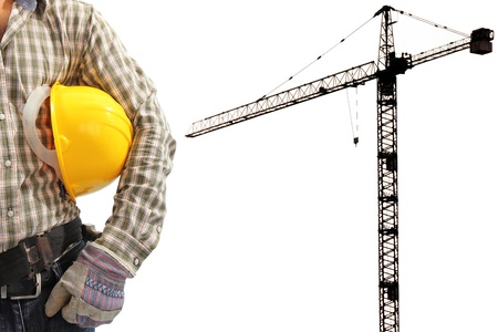 Worker and the silhouette construction tower crane in background with space for your text