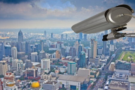security monitoring: cctv security system outdoor to monitor outside building  from skyscraper rooftop
