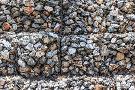 gabion: Natural stones in retain a galvanized steel mesh of gabion wall