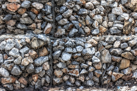 Natural stones in retain A Steel mesh of gabion wall photo