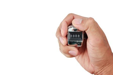 Hand, die einen Zähler mit Null-Nummer im Display isoliert auf weiß Standard-Bild - 22022258