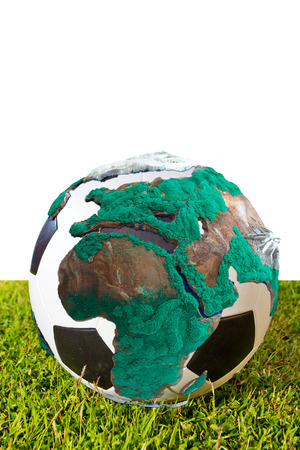 enveloped: soccer ball enveloped the world map isolated on white background with clipping path Stock Photo