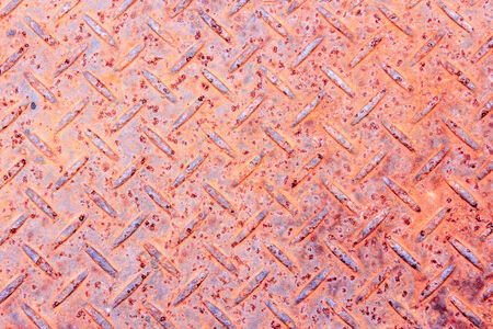 a sheet of rusty old diamond plate metal photo