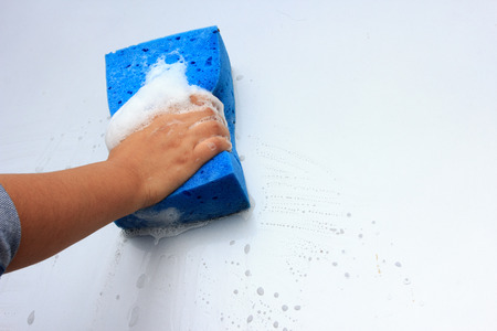 cleaning car wash with a sponge photo
