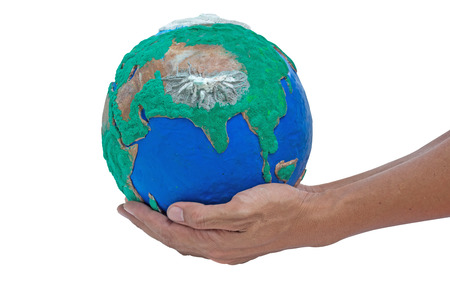 man his hands holding globe made from clay on  isolate on white with clipping path photo