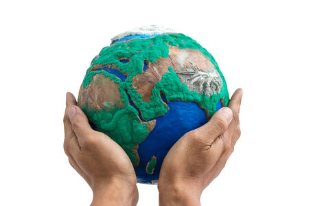 man holding globe made from clay on his hands isolate on white with clipping path photo