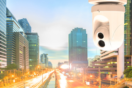 Security Camera or surveillance Operating on traffic road and urban scene in sunset  Stock Photo