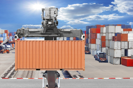 Forklifts container being unloaded at the harbor Standard-Bild