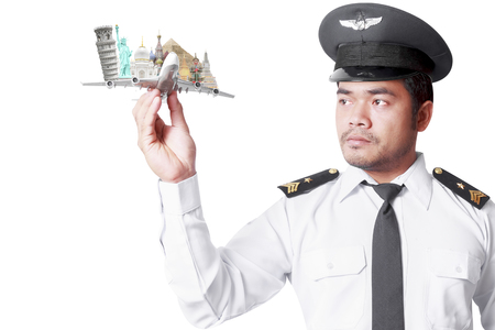 Pilot looking at model airplane concept travel around the world isolated on white background with clipping path