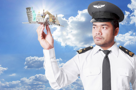 Pilot looking at model airplane concept travel around the world