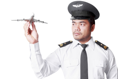 Pilot looking at model airplane isolated on white background with clipping path