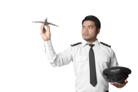 Pilot with model airplane isolated on white background with clipping path