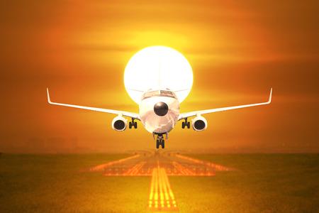 Front view passenger aircraft takeoff on runway in sunset Standard-Bild