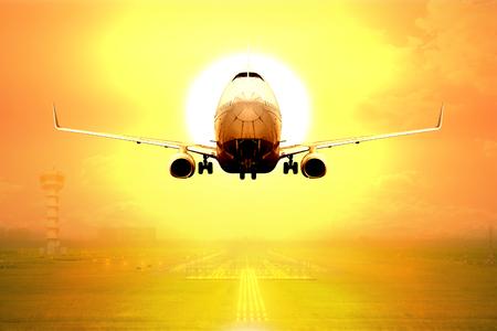 Passenger aircraft takeoff on runway of airport in sunset Standard-Bild