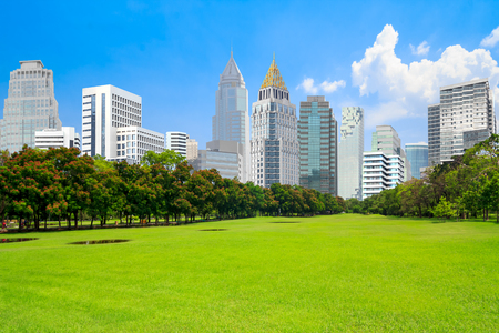 View of Park scenery with Urban scene in financial district landmarks,at Bangkok,Thailand.