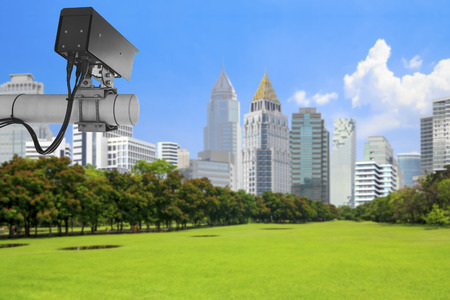 CCTV Security Camera or surveillance and view of Park scenery with urban scene in financial district landmarks