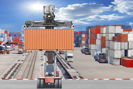 Forklifts container being unloaded container commercial delivery cargo at the harbor Standard-Bild