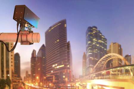 CCTV Security Camera or surveillance Operating on traffic road and urban scene in sunset