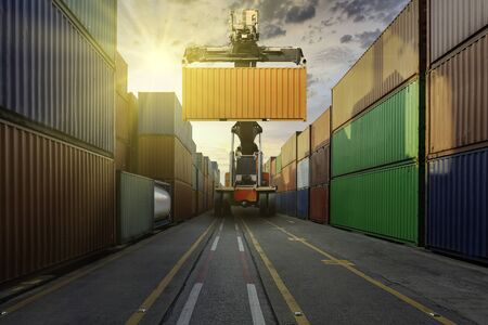Forklift and container cargo in sunrise with logistics import export and transportation concept Standard-Bild