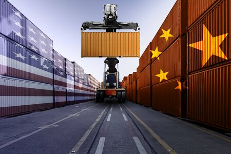 Metaphor image of United States of America and China trade war tariffs as two opposing container cargo and forklift in the port as an economic taxation dispute over import and exports concept