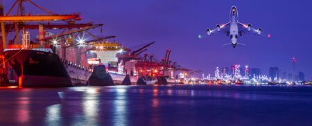Panorama image of Container cargo ship with ports crane bridge loading dock to terminal in harbor against refinery industrial at twilight Standard-Bild