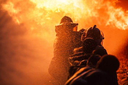 flames: Formaci�n Bomberos Foto de archivo