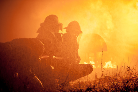 fire team: Firefighters training. Stock Photo