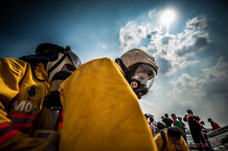 protective suit: Firefighter with mask and airpack fully protective suit Editorial