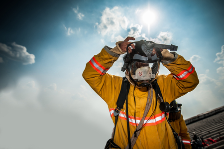 protective suit: Firefighter with mask and airpack fully protective suit Stock Photo