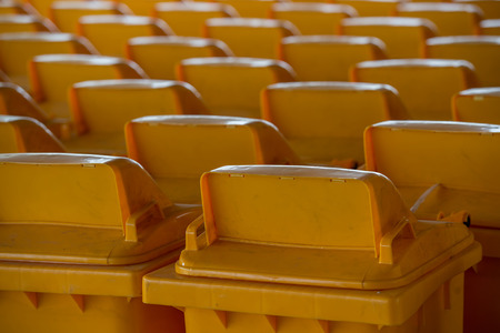 yellow recycling bin Stock Photo