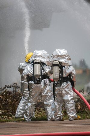 hazardous material team: Fire departments & emergency response teams suited up with PPE to protect them from hazardous materials as they investigate this disaster.