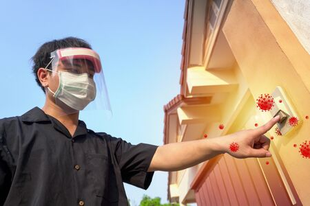 Preventive measures against Covid-19 infection. the man touching door bell without glove.