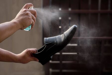 Preventive measures against Covid-19 infection. A man cleans his shoes Stockfoto
