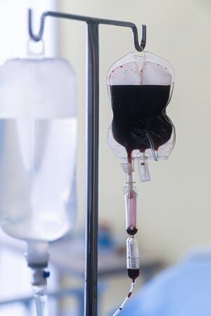Spare blood bags from laboratory medical hanging on a steel pole at the hospital In order to prepare blood for the veins of the patients who want to donate blood in the same group