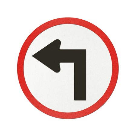 Turn Left traffic sign recycled paper on white background. photo