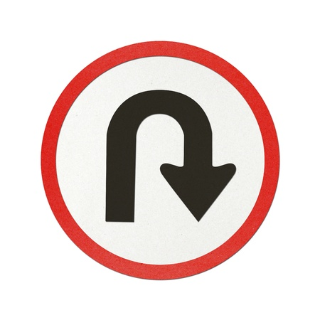 U – Turn traffic sign recycled paper on white background.