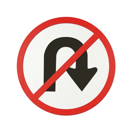 No U – Turn traffic sign recycled paper on white background. photo