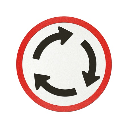 Roundabout Ahead traffic sign recycled paper on white background. photo