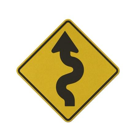 Left Winding Road traffic sign recycled paper on white background. photo