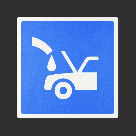 Fill car radiator traffic sign recycled paper on white background. photo