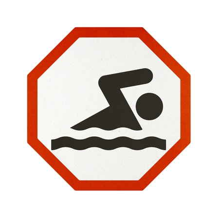 Swimming traffic sign recycled paper on white background. Stock Photo