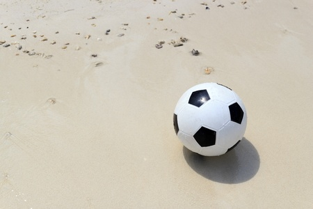 Soccer ball on beach. Stock Photo