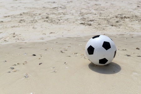 Soccer ball on beach. photo