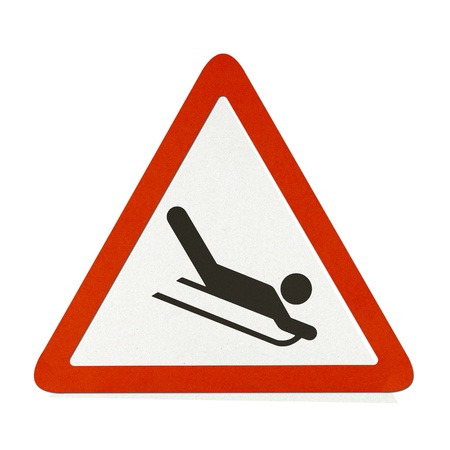 Snow Sledging traffic sign recycled paper on white background. Stock Photo