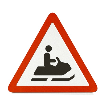 Snowmobile traffic sign recycled paper on white background. photo