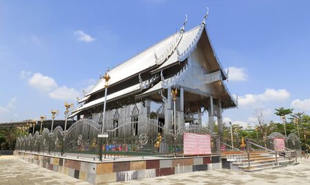 Stainless steel temple on clear blue sky in thailand.