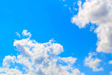 White fluffy clouds in the blue sky Stock Photo - 13487988