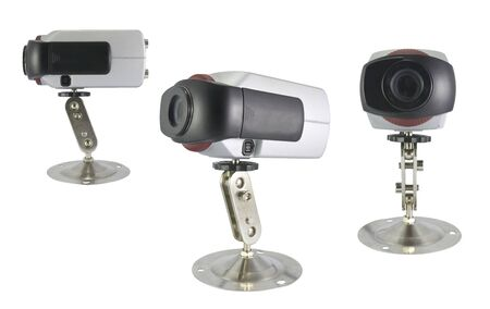 Side and front view of a surveillance camera isolated on white background.